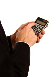 man holding calculator